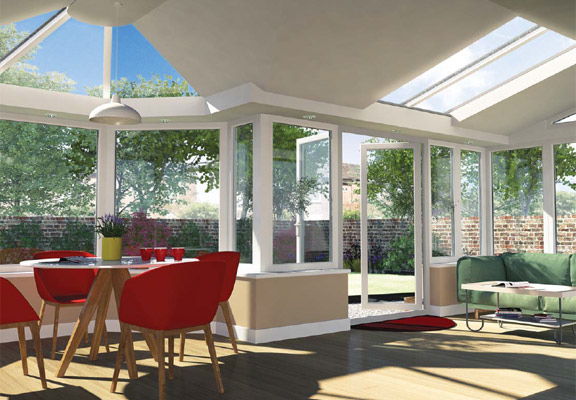 LivinROOF-Conservatory Roofing With Red Chairs